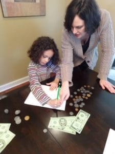 Mom using new allowance strategy with daughter